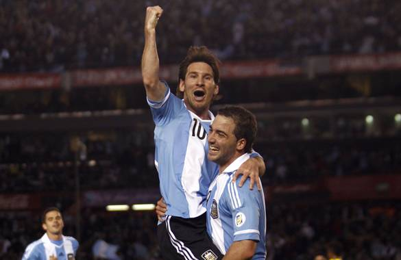 Argentina's Messi celebrates with teammate Higuain after he scored a goal against Ecuador during a World Cup qualifying soccer match in Buenos Aires