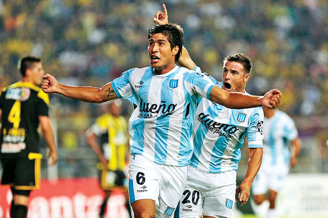 Lollo of Argentina's Racing Club celebrates after scoring against Venezuela's Deportivo Tachira during their Copa Libertadores soccer match in San Cristobal