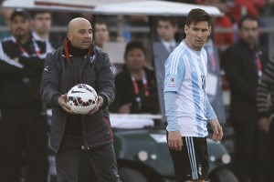 Argentina's Lionel Messi, right, walks past Chile's coach Jorge Sampaoli, left, during the Copa America final soccer match at the National Stadium in Santiago, Chile, Saturday, July 4, 2015. (AP Photo/Ricardo Mazalan)